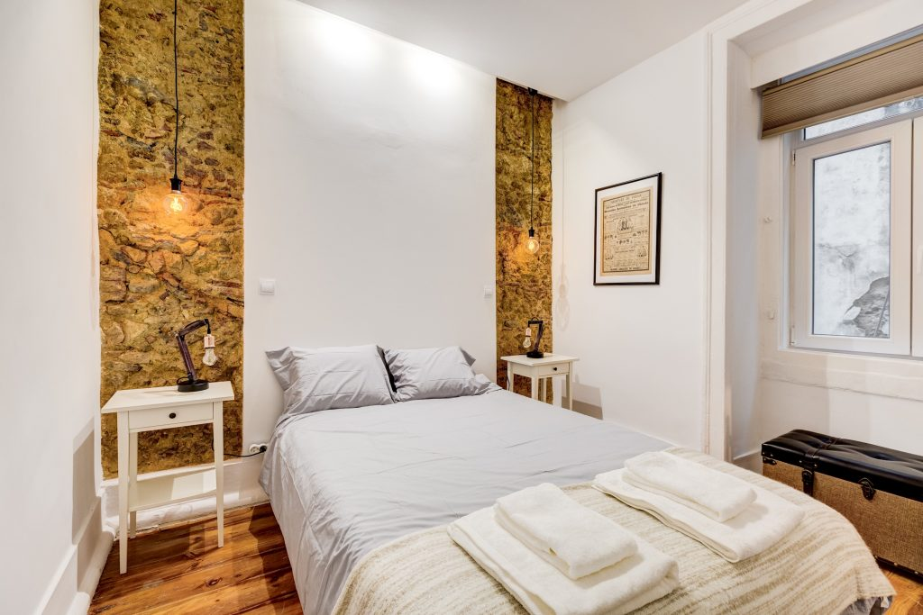 Gem Lisbon Rental Apartment, Historical Gem in Baixa, bedroom, stone wall