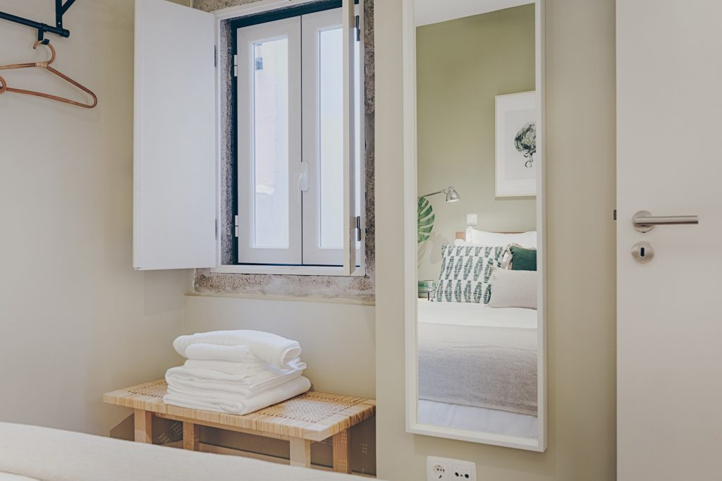 Gem Lisbon Rental Apartment, Historical Gem in Santa Catarina, bedroom, mirror, towels