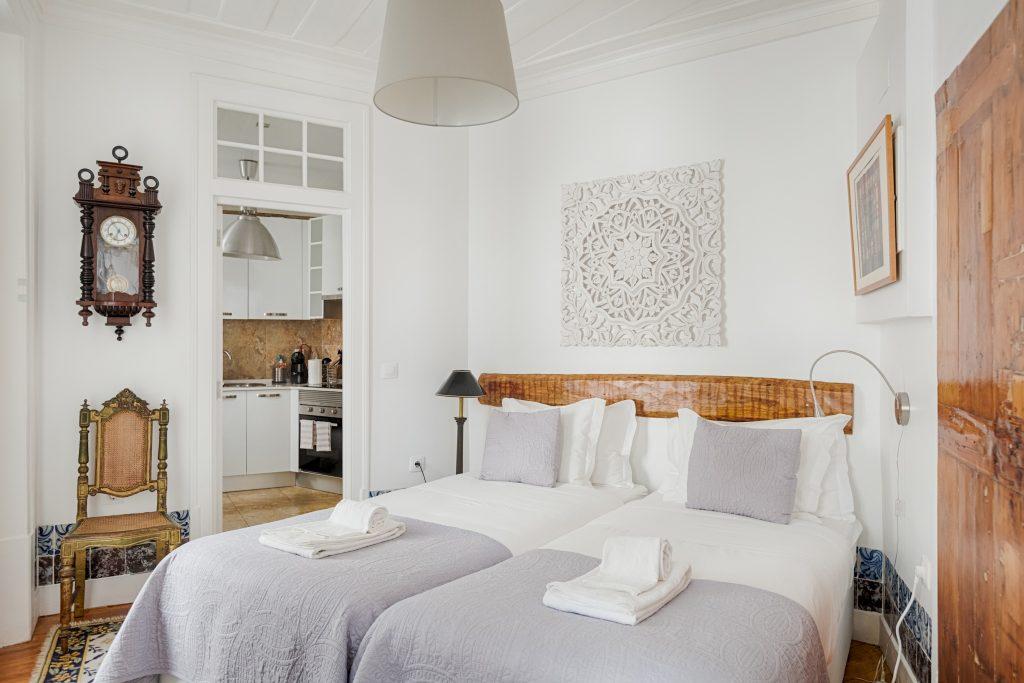 Gem Lisbon Rental Apartment, Historical Gem in Trendy Chiado, bedroom, old wooden furniture