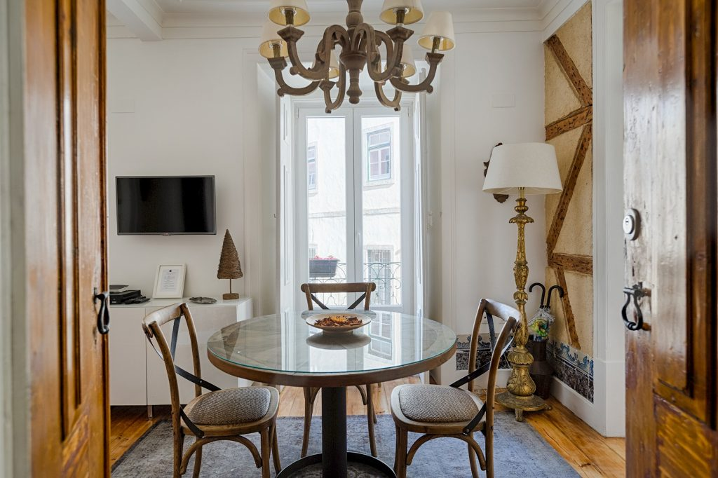 Gem Lisbon Rental Apartment, Historical Gem in Trendy Chiado, dining room, old wood building structure