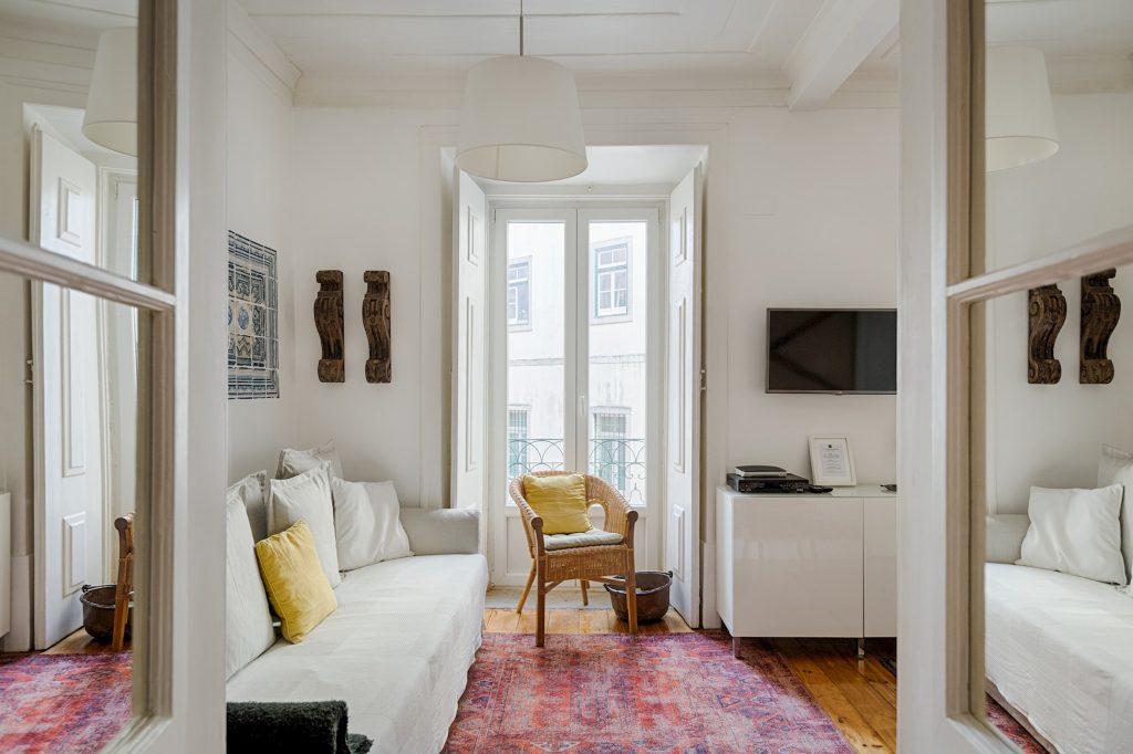 Gem Lisbon Rental Apartment, Historical Gem in Trendy Chiado, living room, red tapestry