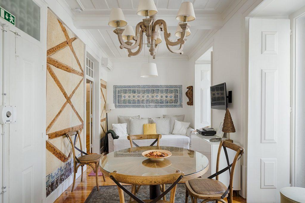 Gem Lisbon Rental Apartment, Historical Gem in Trendy Chiado, living room, old wood building structure, old lisbon handpainted tiles