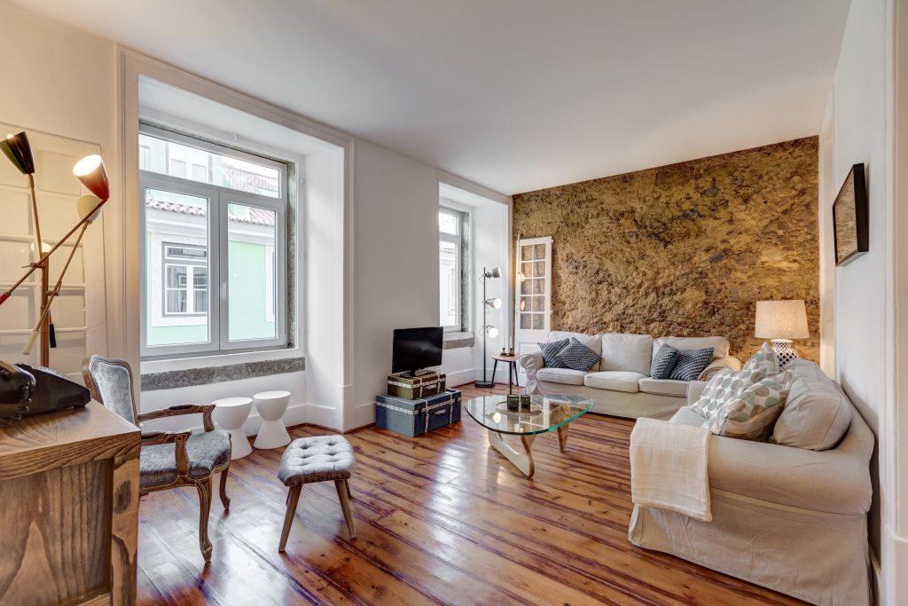 Gem Lisbon Rental Apartment, Historical Gem in Baixa, living room, stone walls